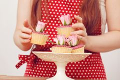 Woman with cupcakes Royalty Free Stock Photos