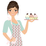 Woman with cupcakes Stock Photography