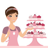 Woman with cupcakes. Baking woman with pink cupcake stand Royalty Free Stock Photo