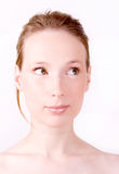 Woman curious face bright Royalty Free Stock Photography