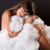 Woman Curled Up With Fluffy Cotton Royalty Free Stock Photos