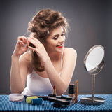 Woman with curler hair Stock Image