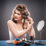 Woman with curler hair Stock Images