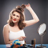 Woman with curler hair Royalty Free Stock Images