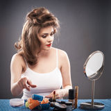 Woman with curler hair Stock Photo