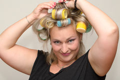Woman with curler Royalty Free Stock Image