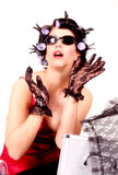 Woman In Curlers. Woman with sunglasses wearing hot rollers or curlers royalty free stock images