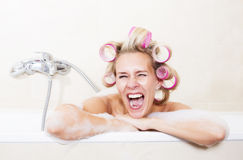 Woman with curlers in bathtub Royalty Free Stock Photos