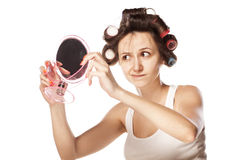 Woman with curlers Royalty Free Stock Images