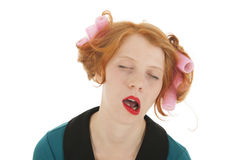 Woman with curlers in hair yawning Royalty Free Stock Photography