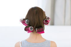 Woman with curlers on her head Royalty Free Stock Photography