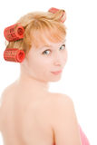 A woman in curlers looking back Stock Photography