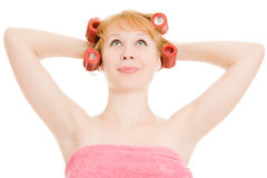 A woman in curlers looking up Stock Photos