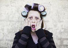 Woman with curlers Royalty Free Stock Photos