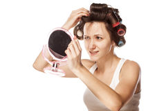 Woman with curlers Stock Photography