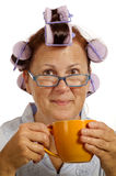 Woman In Curlers Smiling And Drinking Coffee Royalty Free Stock Photos