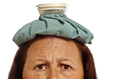 Mature Woman With Ice Pack For Headache  Stock Photography