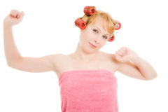 Woman in curlers stretched Stock Image