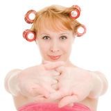 Woman in curlers stretched Stock Photography