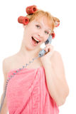 A woman in curlers talking on the phone Stock Photo