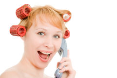 A woman in curlers talking on the phone Stock Images