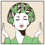 Woman with curlers in their hair. Pop Art illustration. Stock Image