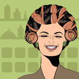 Woman with curlers in their hair Stock Photography