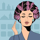 Woman with curlers in their hair Royalty Free Stock Photos