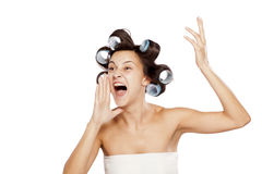 Woman with curlers yelling Stock Photo