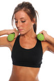 Woman Curling Dumbbells Stock Image