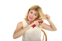 Woman Curling Hair 1 Stock Images