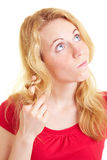 Woman curling hair. Pensive woman curling her hair around her finger stock photo