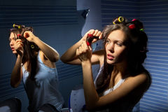 Woman curling her hair stock photo