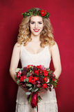 Woman with Curly Blond Hair. Bride with Flowers Royalty Free Stock Image