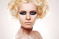 Woman with curly blond hair and evening make-up royalty free stock photo