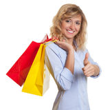 Woman with curly blond hair loves shopping Stock Images