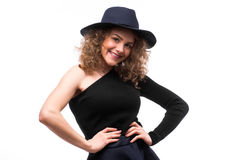 Woman with curly hair in black hat and stylish elegant evening dress Stock Photos