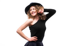 Woman with curly hair in black hat and stylish elegant evening dress Royalty Free Stock Image