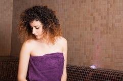 Woman with curly hair enjoying a turkish sauna Royalty Free Stock Photos