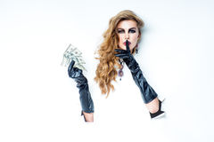 Woman with curly hair holding money Royalty Free Stock Images