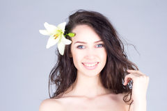 Woman with curly hair  playing with her hair. Hawaiian mood. Stock Photo