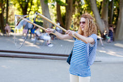 Woman with curly hair pull soap bubbles Stock Photography