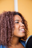 Woman With Curly Hair Singing In Recording Studio Stock Photography