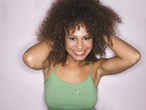 Woman With Curly Hair Smiling Stock Image