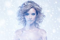 Woman with curly hair and winter theme Royalty Free Stock Photography