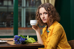 Young fashion woman drinking tea at restaurant Stock Images