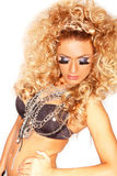 Woman with curly hairstyle and covered in chains Stock Image