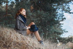 Woman with curly red hair outdoors Stock Photo