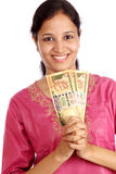 Woman with currency Royalty Free Stock Photo