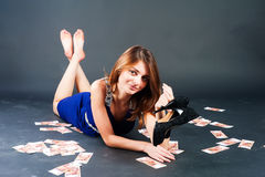 Woman among currency Royalty Free Stock Photos